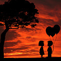 The Gift Girl Boy Balloons Sunset Silhouette Series   by David Dehner