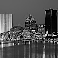 The Rochester Skyline Reflecting The The Genesee River Rochester Ny Blue Building Black And White by Toby McGuire