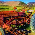 Tractor In Pumpkin Field by Garry Gay
