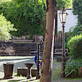 tree lamp and old water pump in Cochem Germany by Victor Lord Denovan