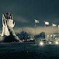 Tulsa Oru Praying Hands And Avenue Of Flags - Sepia  by Gregory Ballos