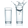 Two Glasses Of Water, One With Splashes by Julichka