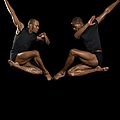Two Male Dancers Jumping by Image Source