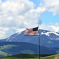 U. S. Flag With Mt. Powell Behind by Kae Cheatham