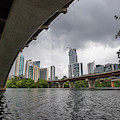 Urban Skyline Of Austin Buildings From Under Bridge With Stormy  by PorqueNo Studios