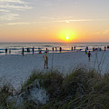 Vacationers Gather To Watch The Sunset Along The Beach On Anna M by William Kuta