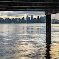 View Of Downtown Seattle At Sunset From Under A Pier by PorqueNo Studios