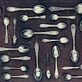 Vintage Set Of Dessert Spoons On A Dark by Evgeniya Porechenskaya