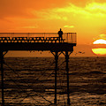 Watching The Sunset From Aberystwyth Pier by Keith Morris