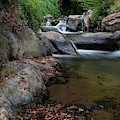 Water Stream On The River With Small Waterfalls by Michalakis Ppalis