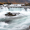 Waterfall On The Fossalar River In Iceland by Mark Hunter