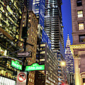 West 42nd Street At Night In New York City by John Rizzuto