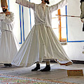 Whirling Dervish  At Mevlana Shrine by Steve Estvanik