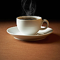 White Cup Of Coffee Sends Up Steam by Hdere