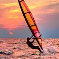 Windsurfing At Sunrise by Jeff Breiman