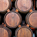 Wine Barrels Stacked Inside Winery by Yinyang