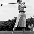 Woman Golfing by George Marks