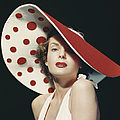 Woman Wearing Large Spotted Hat by Tom Kelley Archive