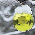 Yellow Christmas Ball Outside, Covered By Snow And House Reflect by Cristina Stefan