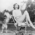 Young Woman And Her Pushy Pet Dog by Everett Collection
