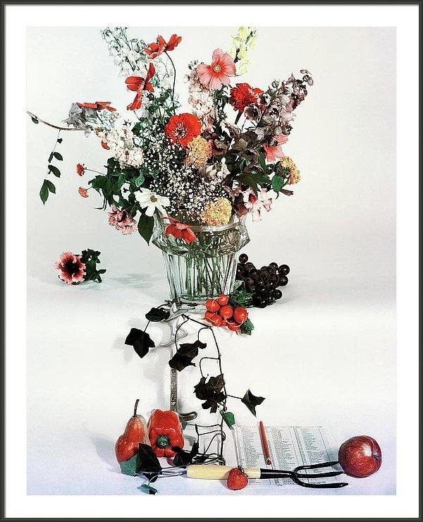 Herbert Matter - A Studio Shot Of A Vase Of Flowers And A Garden
