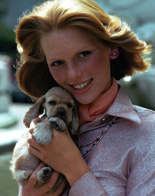 William Connors - Patti Hansen Carrying A Puppy