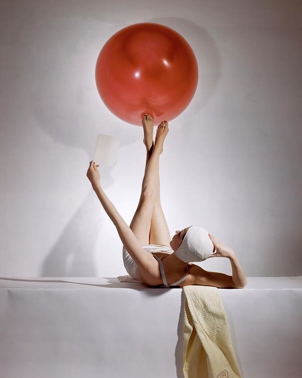 Horst P Horst - A Model Balancing A Red Ball On Her Feet