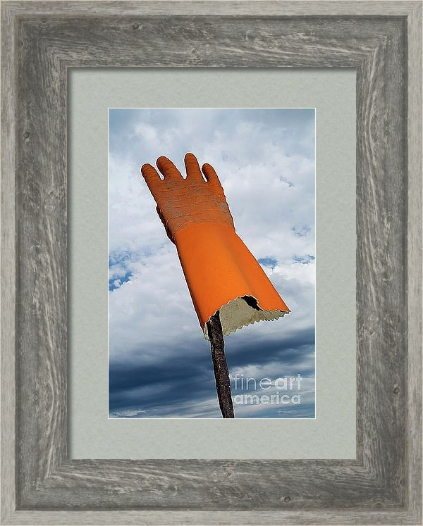 Sami Sarkis - Orange rubber glove on a wooden post against a cloudy sky