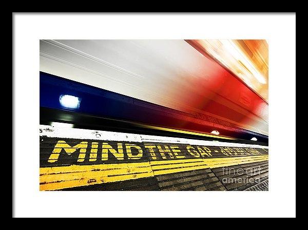 Michal Bednarek - London underground. Mind the gap sign, train in motion