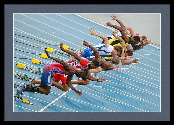 Science Photo Library - Sprinters leaving their blocks