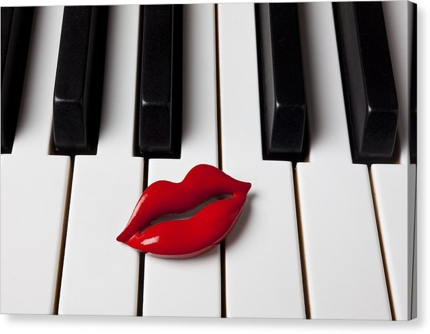 Red lips on piano keys by Garry Gay