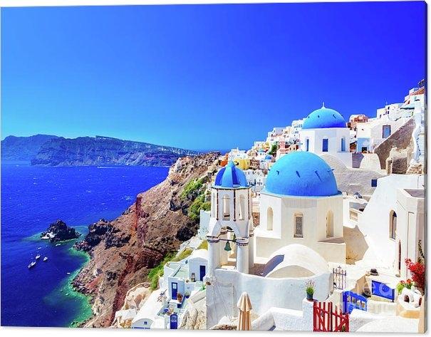 Oia town on Santorini island, Greece. Caldera on Aegean sea. by Michal Bednarek