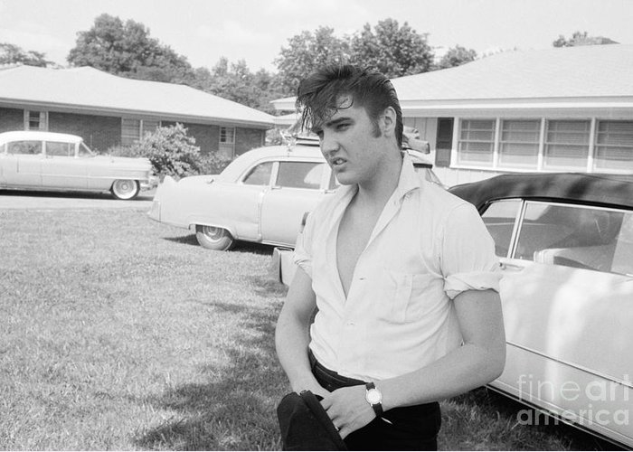 Elvis Presley with his Cadillacs by The Harrington Collection