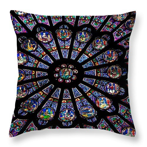 Rose Window .Famous stained glass window inside Notre Dame Cathedral. Paris by BERNARD JAUBERT