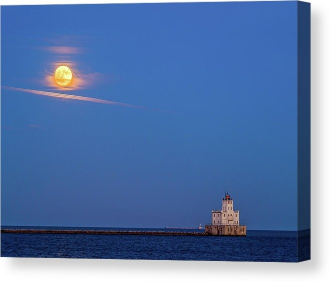 Supermoon over the white lighthouse by Kristine Hinrichs