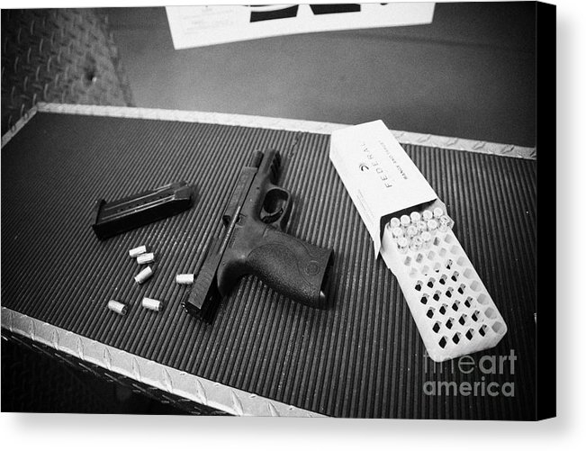 smith and wesson 9mm handgun with ammunition by Joe Fox